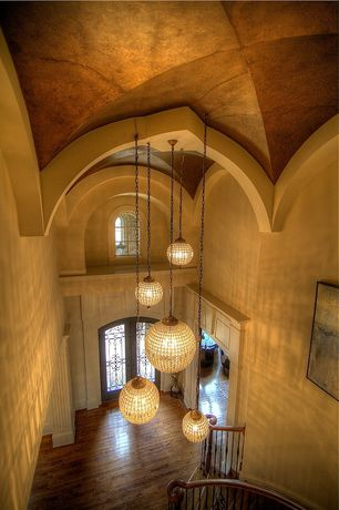 Mediterranean Entryway with Cathedral ceiling Arched