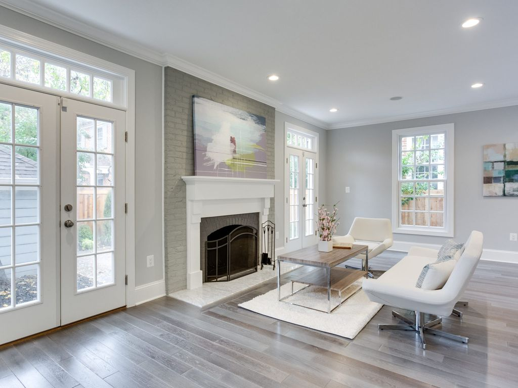 Living Room with Cement fireplace & Hardwood floors in