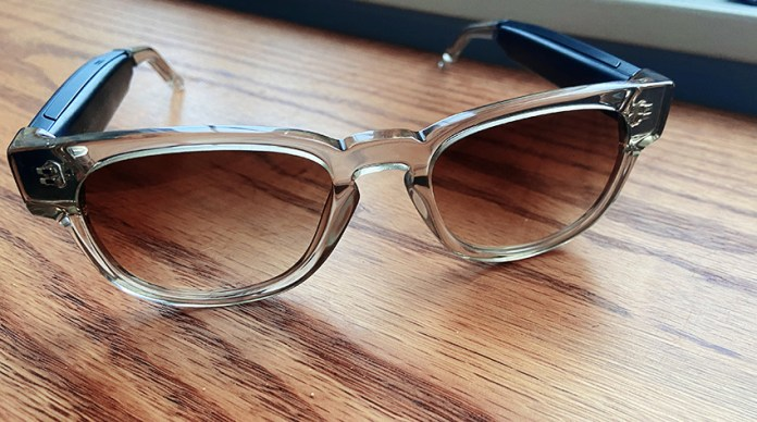 The lenses are tinted brown, but are not particularly dark, making them acceptable for most daily wear