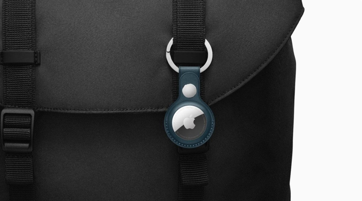 Apple AirTag with baltic blue key ring on black laptop bag