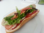 this was lunch today: baguette, tomato, mozz, olive oil, arugula, smoked ham.