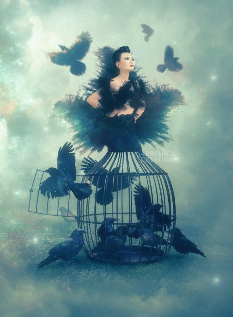 girl in a cage with birds