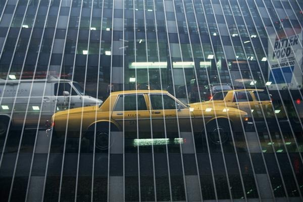Reflection of Vehicles on Mirrored Building, Low Angle View