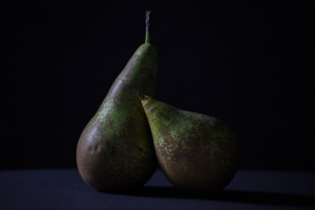 Pears in a photostuido with black background.