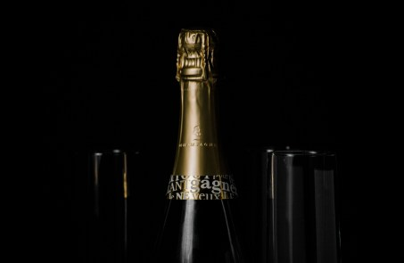 Food photography. Champagne on black background.