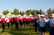 Crowds part for the Calgary Stampede Showband's performance which kicked off breakfast.