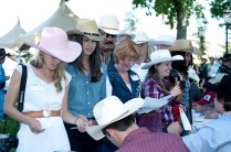 Lucky ladies getting autographs from the rodeo stars...