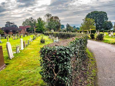 Path leading to church through cemetery