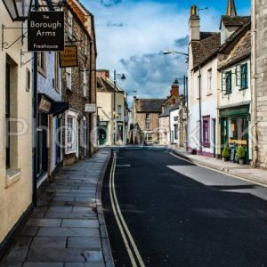 Tetbury, Gloucestershire, United Kingdom April 22 2012. View of a typical street with signs and road markings - Photo Walk UK