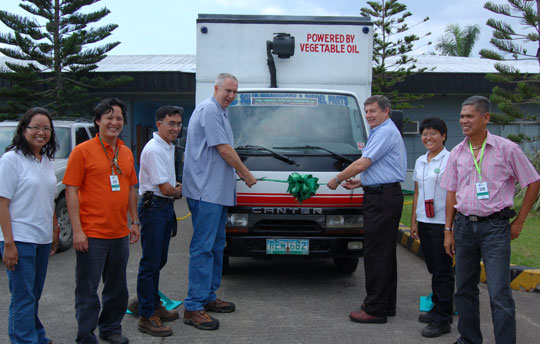 The vegetable oil-powered truck being inaugurated by Covanta (Phils) General Manager Frank Thiel, 3rd from right, and Facility Manager Jim Willey, 4th from left. With them are key managers of the Quezon Power Plant. Second from left is Engr. Chips Guevarra of Alterenergy Systems Inc, SVO supplier who converted the truck for straight vegetable oil fuel.