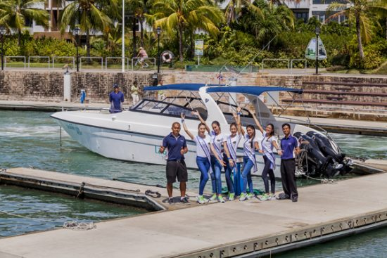 With Laguna Tours' crew in front of Laguna Tours' speed boat before a trip to nearby island.