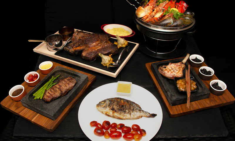 Indulge in the world-famous steak and seafood at La Gritta