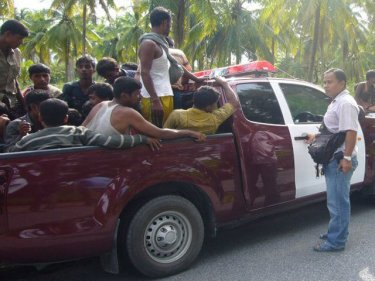 Captive Rohingya crowd into a local police pickup north of Phuket