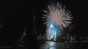 Watching the Waikiki fireworks show from the water. This is the first time I've ever been surfing and I did it at night.