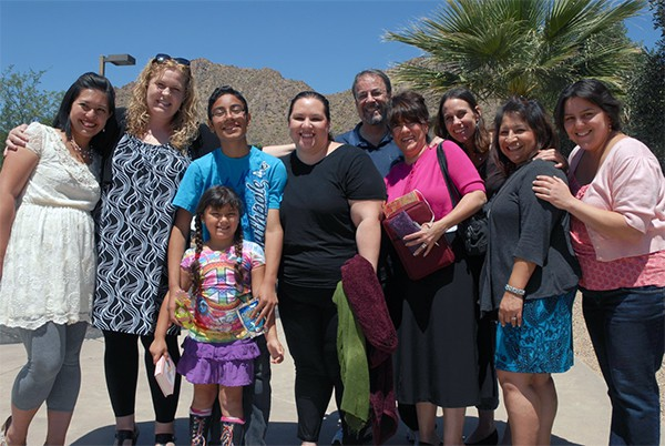 Christine Melgar with her family, children, and the sisters who studied the bible with her after her baptism!