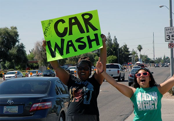 Dani and Naomi rally to get everyone fired up about our Special Missions car wash!