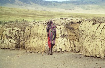 A Maasai tribesman stood against a mud house in a kraal, a compound made up of many mud houses, near the Ngorongoro Crater. The Maasai depend heavily on their cattle, since they are the main source food, e.g., milk, blood, and meat.