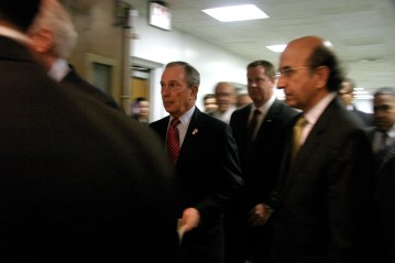 Mayor Bloomberg and NYC Schools Chancellor Joel Klein with staff enter the press conference.