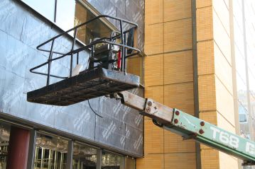 Attached to a truck, the hydraulic life is used for doing repairs/maintenance without scaffolding on high structures.