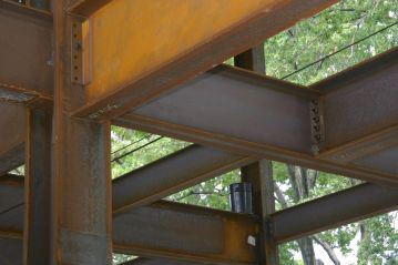 Nuts and bolts are holding the steel beams together.