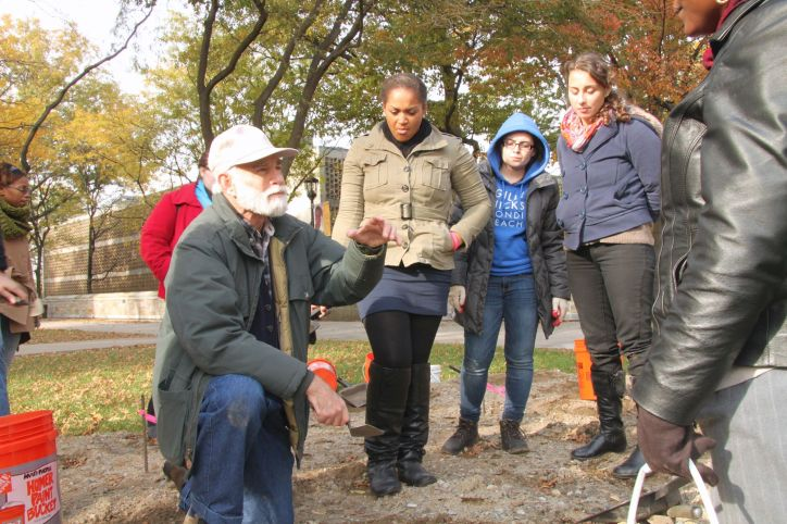 Professor Louis Flam explains the different tools used during an excavation.