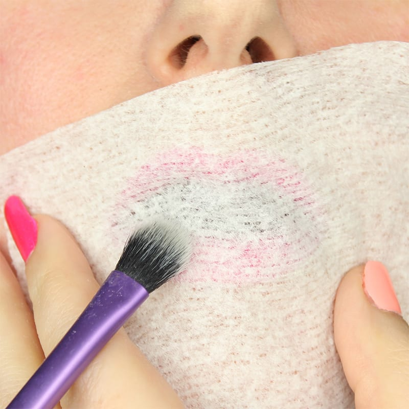 You may already know my favorite lipstick hack. After you've applied your lipstick and blotted it, take a tissue and hold it over your lips, then use a brush to sweep setting powder over your lips. This will help your lipstick last longer.