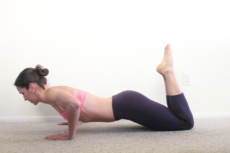 Pushups on your knees help you focus on proper form to finish this banish back fat workout