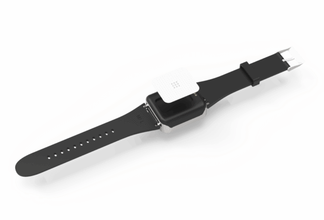Photo of a watch with an adhesive patch underneath it.