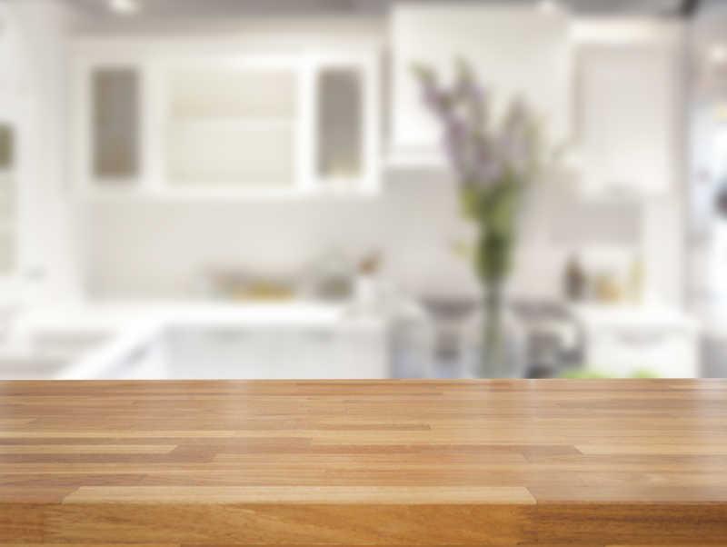 wooden kitchen table ceramic cabinet knobs 空空的木桌图片 模糊的厨房背景前崭新的木桌素材 高清图片 摄影照片 寻图 模糊的厨房背景前崭新的木桌