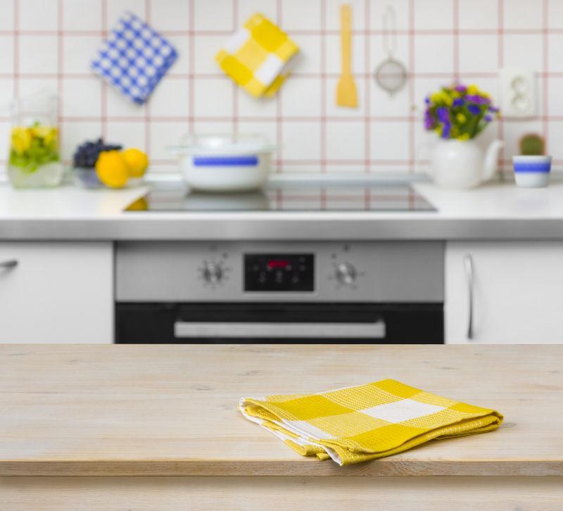 kitchen napkins appliance suites 厨房图片 厨房背景的黄色餐巾木桌素材 高清图片 摄影照片 寻图免费打包下载 厨房背景的黄色餐巾木桌