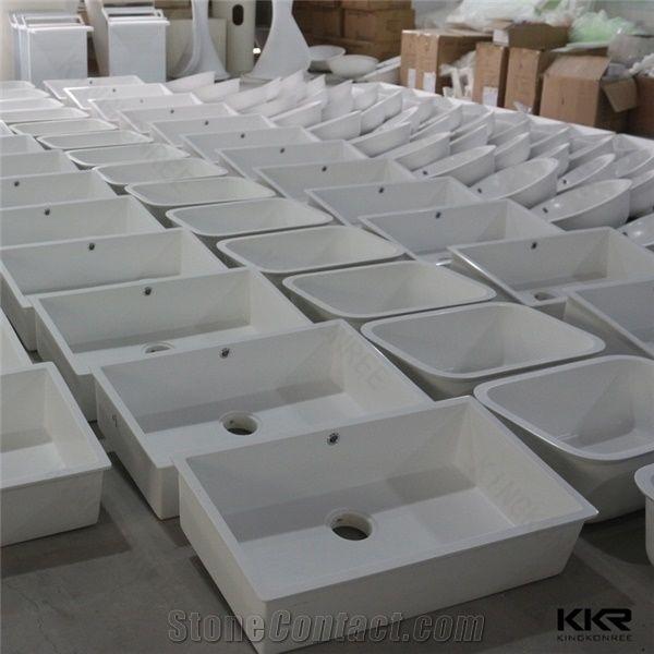 white rectangle shape wash basin