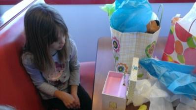 Haylee admiring her long desired music box.