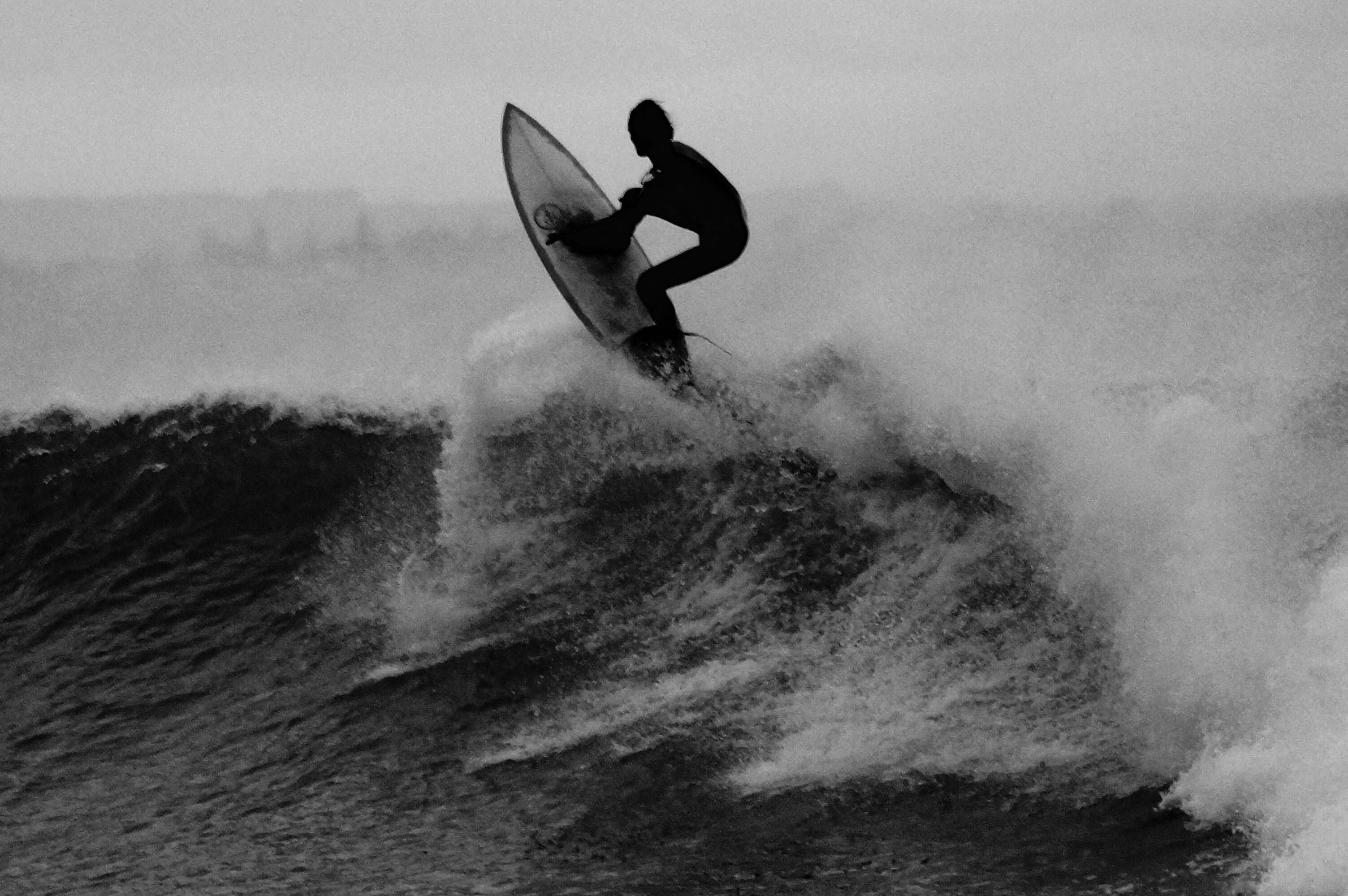 Picallscom  Surfer black and white by Unsplash