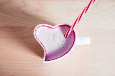Download Strawberry Milkshake in Lovely Heart Shaped Cup Free Stock Photo