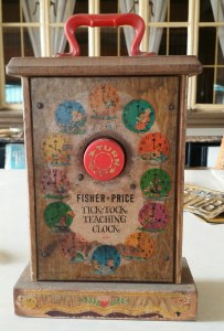 fisher price toy clock back