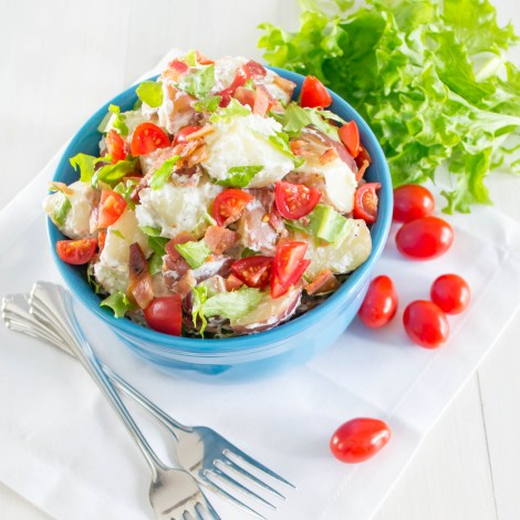 This BLT Potato Salad is so delicious! It is a combination of creamy red potatoes, crisp bacon, sweet tomatoes, and garden fresh lettuce.  | Pick Fresh Foods