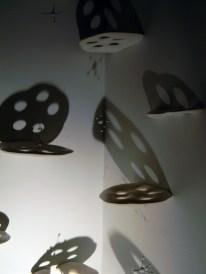 drop. detail. porcelain, ceramic, terra sig, nichrome wire, light, shadow. 5 ft. x 3 ft. x 9 ft. area installed. 2013