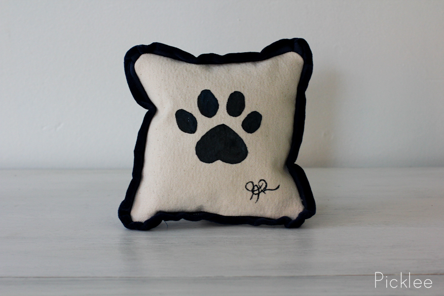 Hand Painted Black Paw Print Pillow by Jennifer Rashleigh
