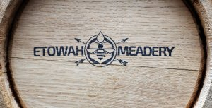 Etowah Meadery logo on the end of a beer barrel.