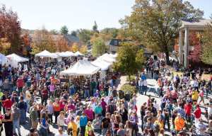 Photo of Dahlonega Gold Rush with crowds walking the downtown square.