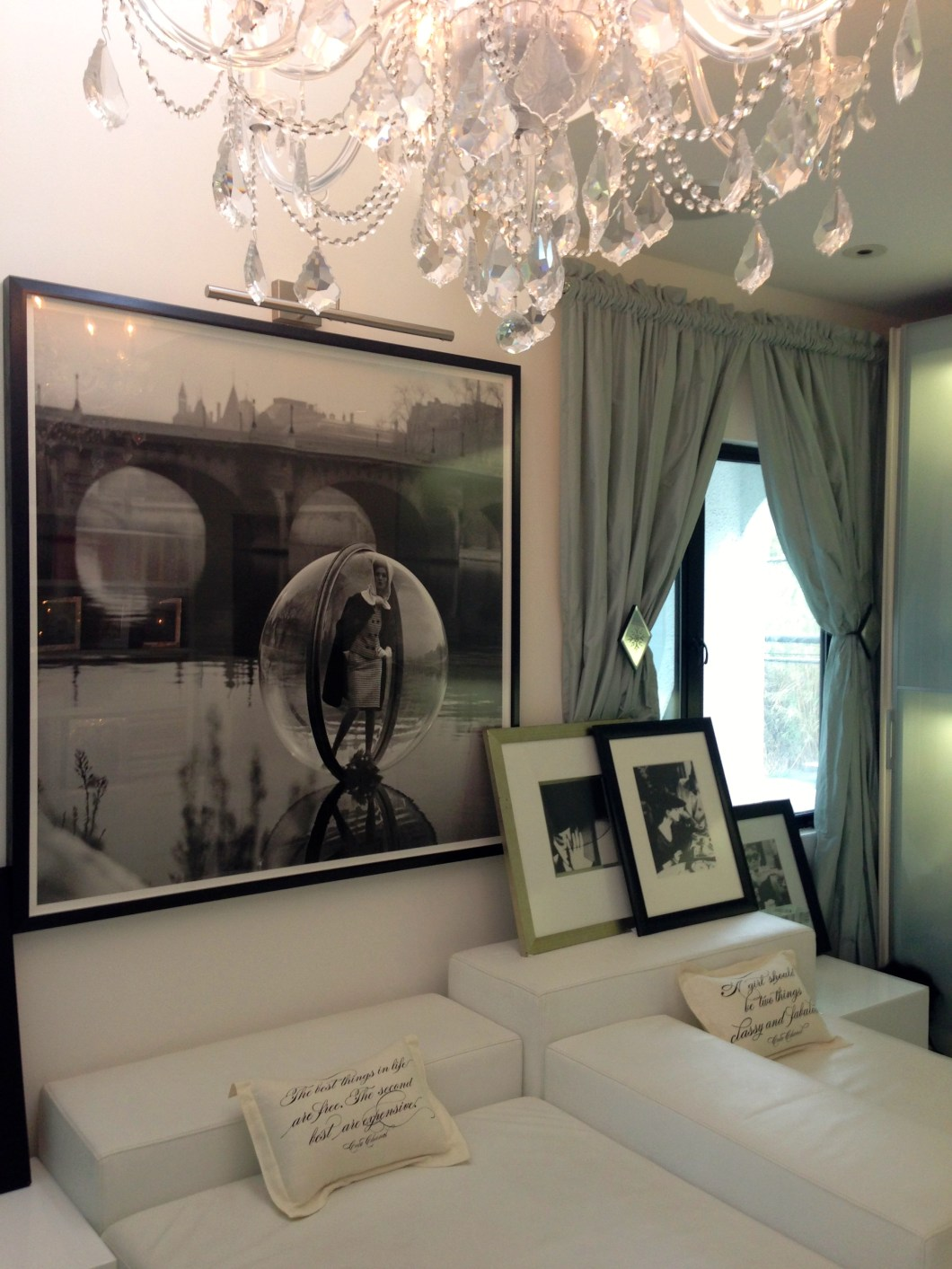 This is my dressing room/fashion library.  It features two beautiful photos by famous fashion photographer, Melvin Sokolsky