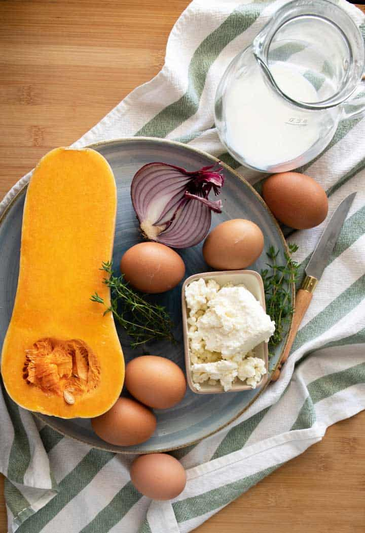 Ingredients laid out for mini pumpkin frittata's for a picnic.