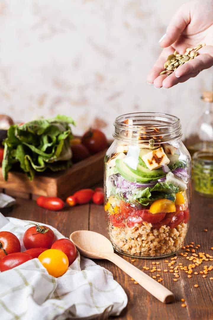 Mason jar filled with salad.