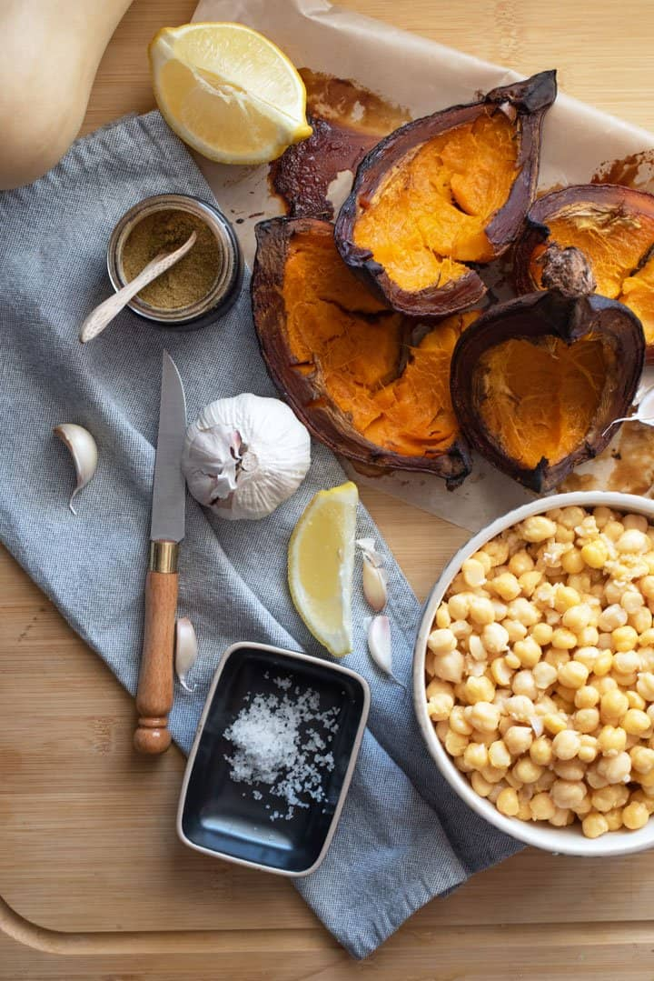 Ingredients laid out for smoked pumpkin hummus.