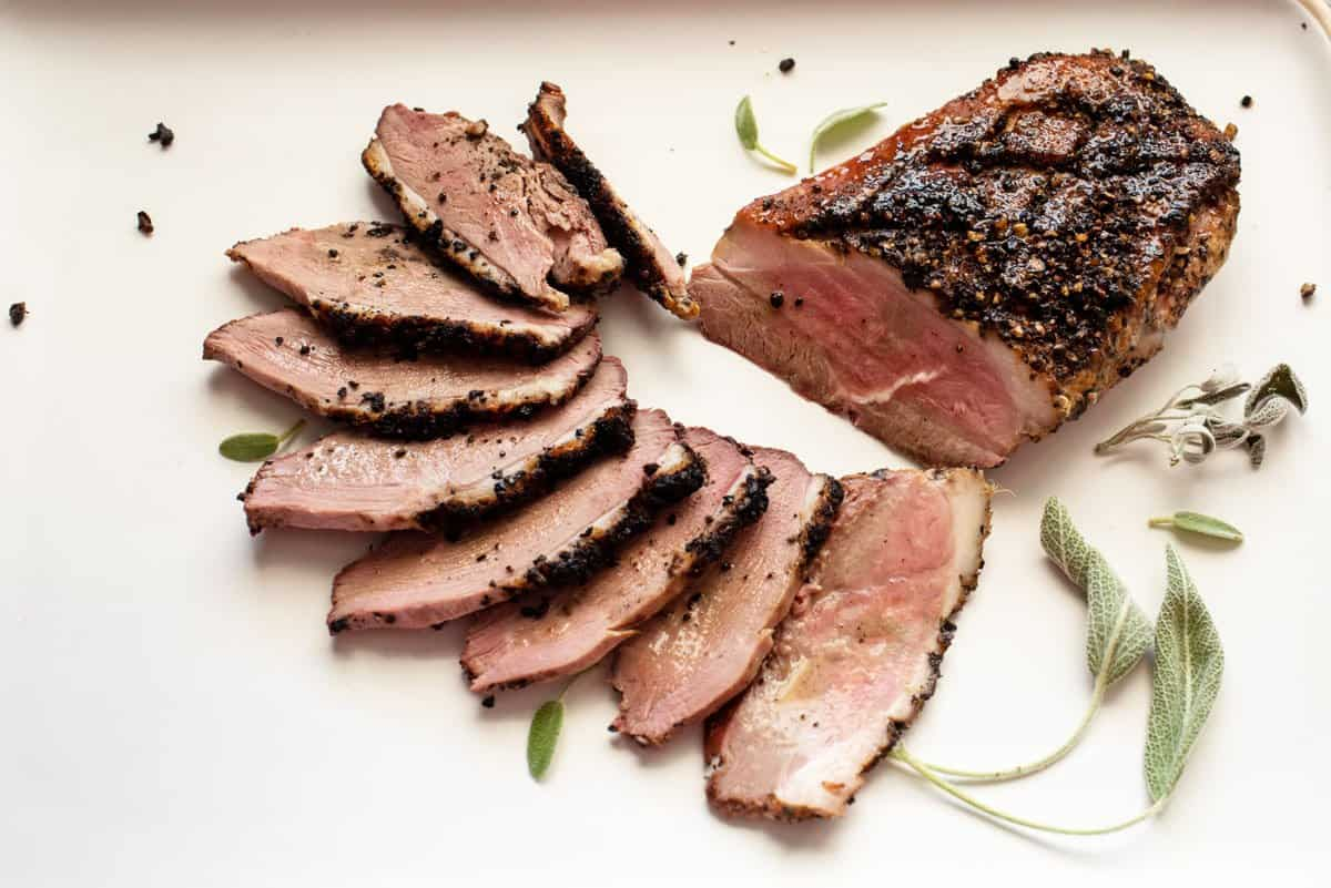 Slices of smoked duck breast with crispy skin.