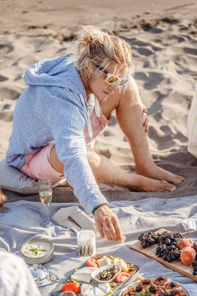 Young surfer looking guy at a beach picnic.