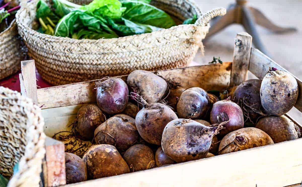 Box of fresh beets at a fruit market.