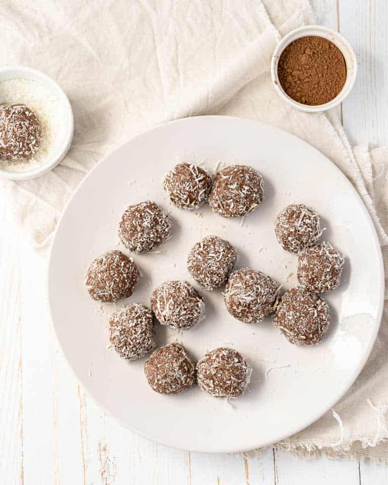 Plate of cocoa peanut butter fat bombs.