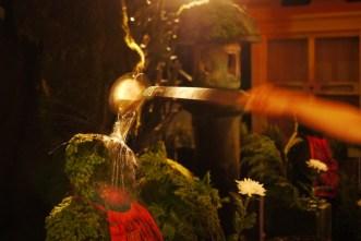 Water on a Jizo statue, Osaka, Japan.