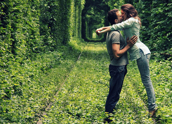 couple-kissing-in-tunnel-of-love-beautiful-photos-of-tunnel-of-love-in-kleven-ukraine